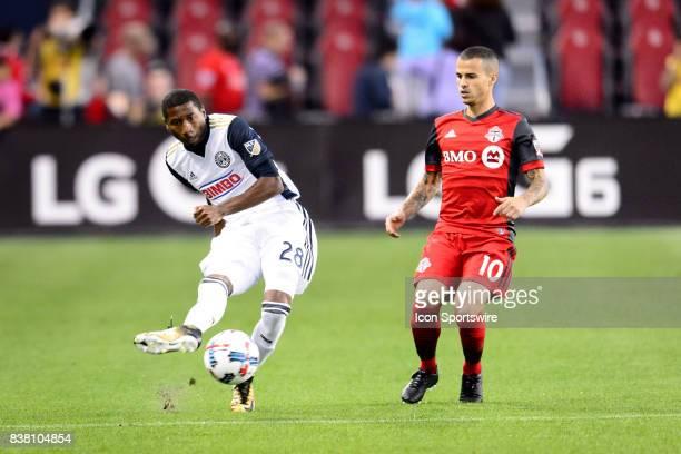 Ray Gaddis of Philadelphia Union passes the ball away from Sebastian Giovinco of Toronto FC during the first half of the MLS Soccer regular season...