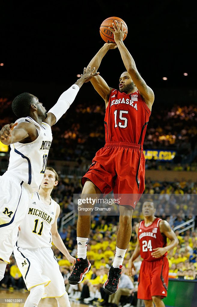 Ray Gallegos #15 of the Nebraska Cornhuskers takes a second half three point shot over Tim Hardaway Jr. #10 of the Michigan Wolverines at Crisler Center on January 9, 2013 in Ann Arbor, Michigan. Michigan won the game 62-47.