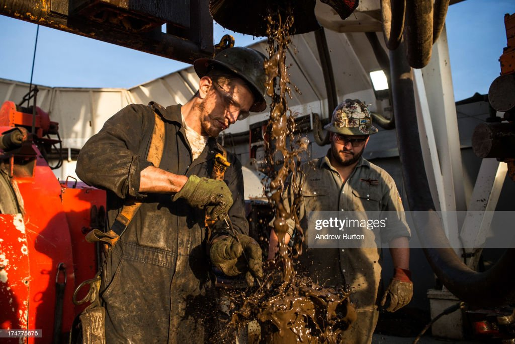 Ray Gerish, a floor hand for Raven Drilling, works on an oil rig drilling into the Bakken shale formation on July 28, 2013 outside Watford City, North Dakota. North Dakota has been experiencing an oil boom in recent years, due in part to new drilling techniques including hydraulic fracturing and horizontal drilling. In April 2013, The United States Geological Survey released a new study estimating the Bakken formation and surrounding oil fields could yield up to 7.4 billion barrels of oil, doubling their estimate of 2008, which was stated at 3.65 billion barrels of oil. Workers for Raven Drilling work twelve hour days fourteen days straight, staying at a camp nearby, followed by fourteen days.