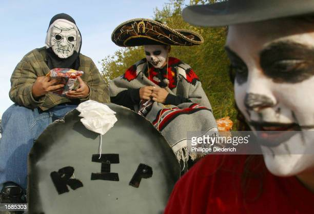 Ray Griego and Emiliano Martinez ride on a float in the 10th annual Day of The Dead Parade November 3 2002 in Albuquerque New Mexico The parade is...