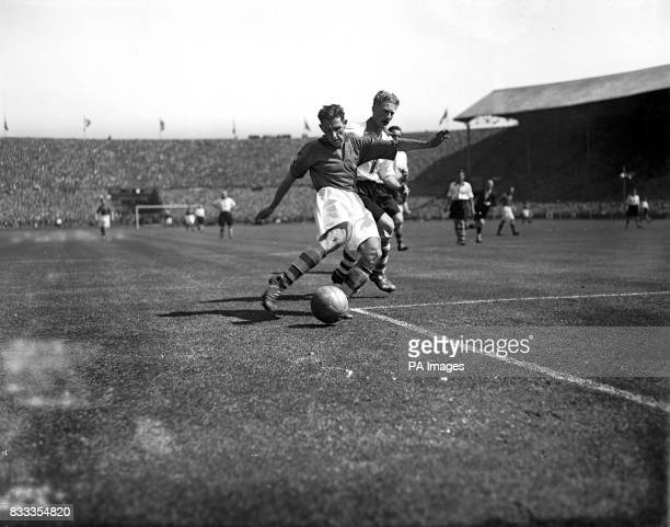 Ray Harrison the Burnley centre forward takes a shot at goal during the first half of the Cup Final against Charlton at Wembley