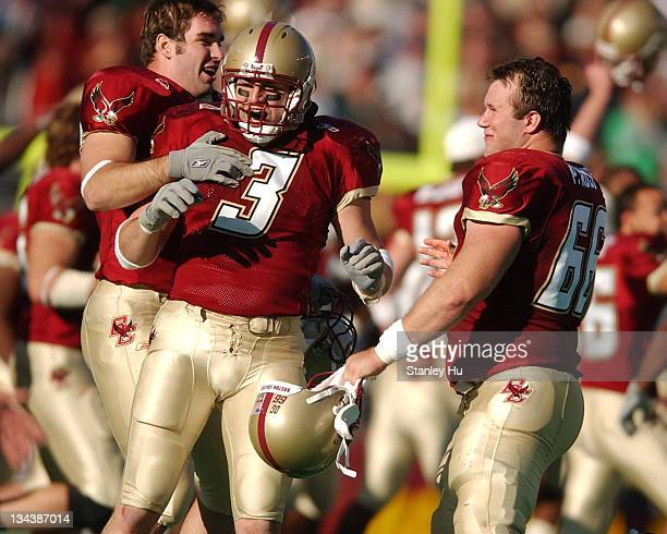 Ray Henderson of Boston College celebrates with Patt Ross during Boston College's 2725 victory over Notre Dame at Alumni Stadium in Newton MA