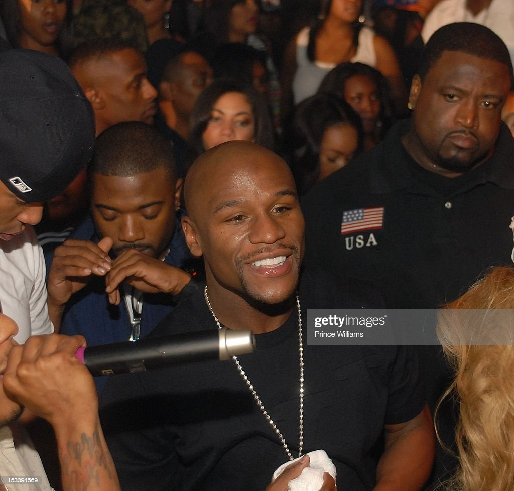 <a gi-track='captionPersonalityLinkClicked' href=/galleries/search?phrase=Ray+J&family=editorial&specificpeople=581007 ng-click='$event.stopPropagation()'>Ray J</a> and Floyd Mayweather attends a party hosted by Gucci and Floyd Mayweather at Life Nightclub on September 29, 2012 in Atlanta, Georgia.