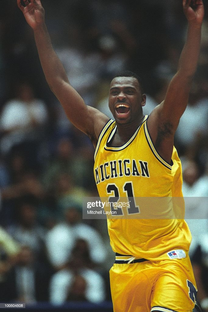 Ray Jackson #21 of the Michigan Wolverines celebrates a shot during a NCAA second round basketball game at the McKale Center on March 21, 1993 in Tuscon, Arizona..