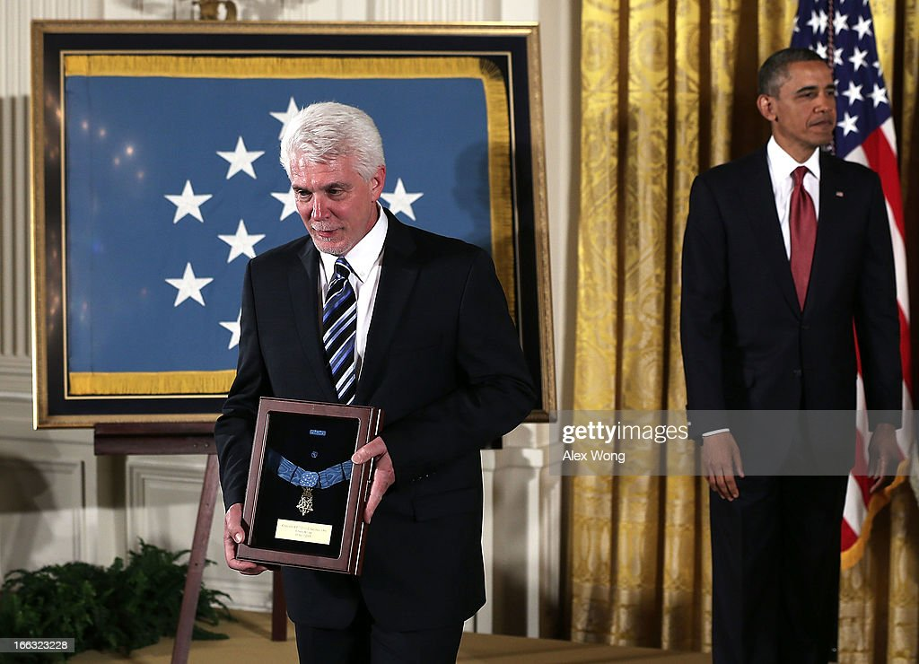 Ray Kapaun (L), nephew of U.S. Army Chaplain (Captain) Emil J. Kapaun, walks off the stage as U.S. President <a gi-track='captionPersonalityLinkClicked' href=/galleries/search?phrase=Barack+Obama&family=editorial&specificpeople=203260 ng-click='$event.stopPropagation()'>Barack Obama</a> (R) loosk on after he was presented with his uncle's Medal of Honor for conspicuous gallantry during an East Room Ceremony April 11, 2013 at the White House in Washington, DC. Chaplain Kapaun received the Medal of Honor posthumously for his extraordinary heroism while serving with the 3d Battalion, 8th Cavalry Regiment, 1st Cavalry Division during combat operations against an armed enemy at Unsan, Korea and as a prisoner of war from November 1-2, 1950.