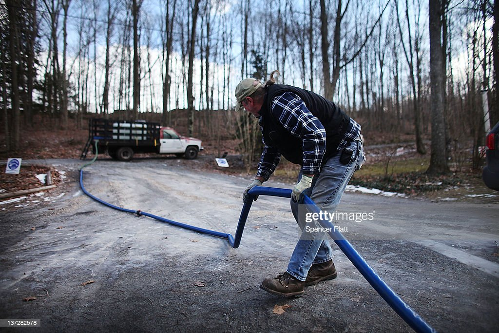 Ray Kemble delivers fresh water to a home that had their water contaminated due to hydraulic fracturing on January 18, 2012 in Dimock, Pennsylvania. Hydraulic fracturing, also known as fracking, stimulates gas production by injecting wells with high volumes of chemical-laced water in order to free-up pockets of natural gas below. The process is controversial with critics saying it could poison water supplies, while the natural-gas industry says it's been used safely for decades. While New York State has yet to decide whether to allow fracking, economically struggling Binghamton has passed a drilling ban which prohibits any exploration or extraction of natural gas in the city for the next two years. The Marcellus Shale Gas Feld extends through parts of New York State, Pennsylvania, Ohio and West Virginia and could hold up to 500 trillion cubic feet of natural gas.