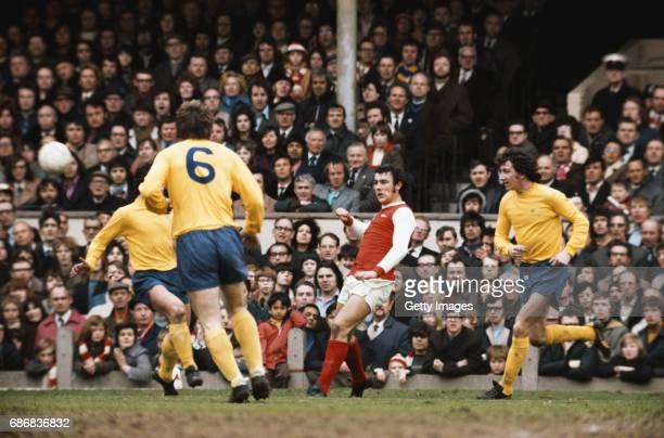 Ray Kennedy of Arsenal in action watched by Roy McFarland of Derby during a First Divsion match between Arsenal and Derby County at Highbury on April...