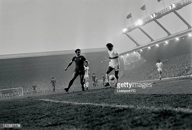 Ray Kennedy of Liverpool challenges Kevin Lock of West Ham United during the English First Division match between Liverpool and West Ham United held...