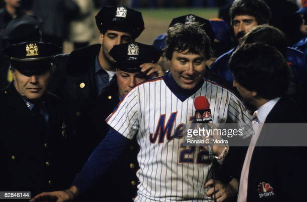 Ray Knight of the New York Mets being interviewed by Marv Albert after the Mets win Game 7 of the 1986 World Series against the Boston Red Sox in...