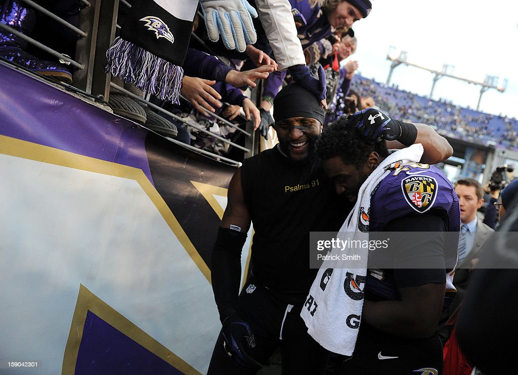 Ray Lewis #52 and Ed Reed #20 of the Baltimore Ravens celebrate after they won 24-9 against the Indianapolis Colts during the AFC Wild Card Playoff Game at M&T Bank Stadium on January 6, 2013 in Baltimore, Maryland.