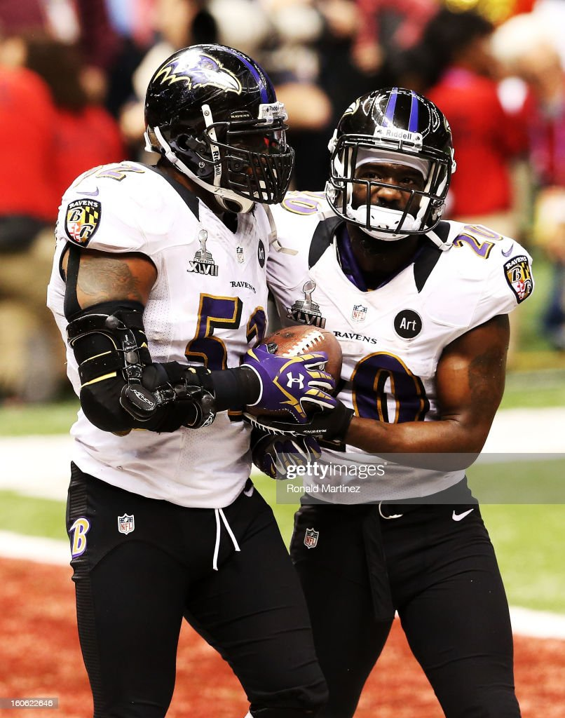 Ray Lewis #52 and Ed Reed #20 of the Baltimore Ravens react after the San Francisco 49ers couldn't convert on a fourth down play in the final two minutes of the fourth quarter during Super Bowl XLVII at the Mercedes-Benz Superdome on February 3, 2013 in New Orleans, Louisiana.