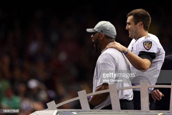 Ray Lewis and Joe Flacco of the Baltimore Ravens celebrate on the trophy podium after defeating the San Francisco 49ers during Super Bowl XLVII at...