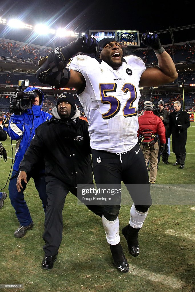 <a gi-track='captionPersonalityLinkClicked' href=/galleries/search?phrase=Ray+Lewis&family=editorial&specificpeople=171809 ng-click='$event.stopPropagation()'>Ray Lewis</a> #52 of the Baltimore Ravens celebrates as he walks off of the field after the Ravens won 38-35 in the second overtime against the Denver Broncos during the AFC Divisional Playoff Game at Sports Authority Field at Mile High on January 12, 2013 in Denver, Colorado.