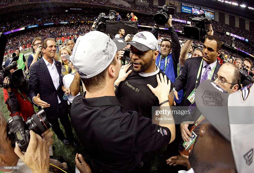 Ray Lewis #52 of the Baltimore Ravens celebrates with head coach John Harbaugh celebrate on the field after the Ravens won 34-31 against the San Francisco 49ers during Super Bowl XLVII at the Mercedes-Benz Superdome on February 3, 2013 in New Orleans, Louisiana.