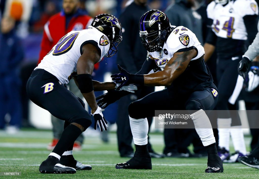 Ray Lewis #52 of the Baltimore Ravens high-fives teammate Ed Reed #20 on the field prior to the 2013 AFC Championship game against the New England Patriots at Gillette Stadium on January 20, 2013 in Foxboro, Massachusetts.