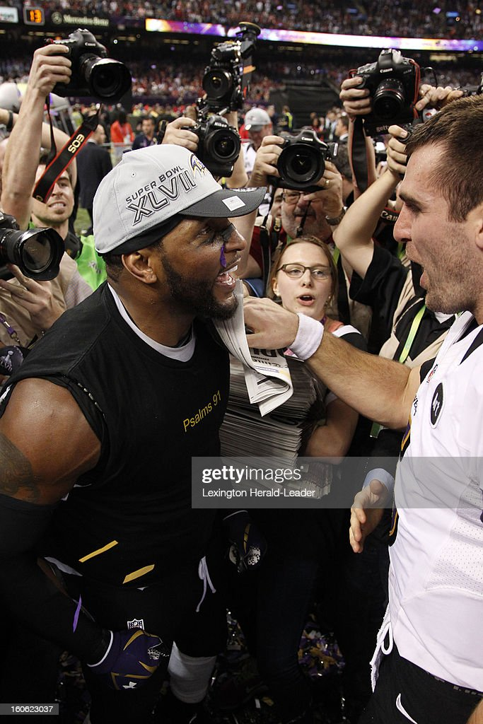 Ray Lewis of the Baltimore Ravens hugs teammate Joe Flacco after a 34-31 win against the San Francisco 49ers in Super Bowl XLVII at the Mercedes-Benz Superdome in New Orleans, Louisiana, Sunday, February 3, 2013.