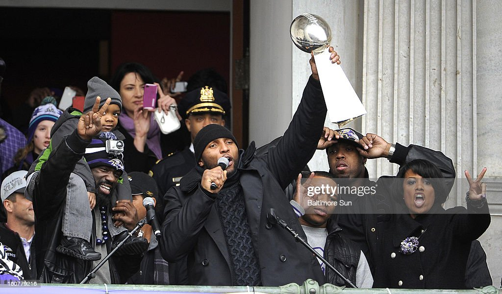 Ray Lewis of the Baltimore Ravens lifts the Lombardi Trophy for the crowd at City Hall in Baltimore, Maryland, Tuesday, February 5, 2013.