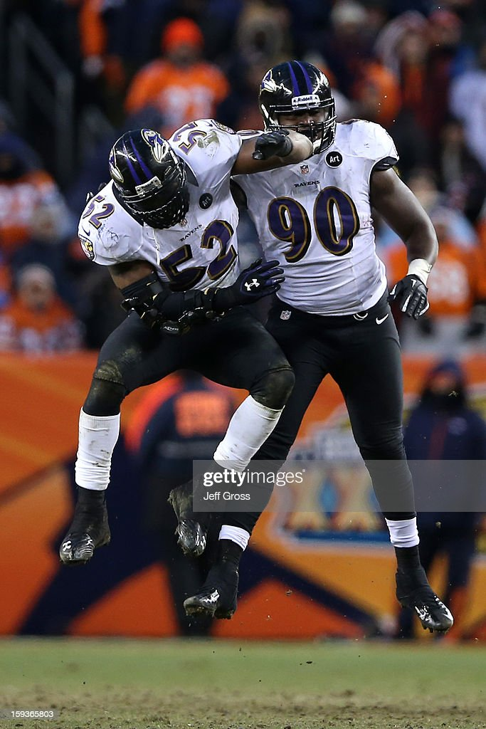 Ray Lewis #52 Pernell McPhee #90 of the Baltimore Ravens react to a defensive stop against the Denver Broncos in the second half against the Denver Broncos during the AFC Divisional Playoff Game at Sports Authority Field at Mile High on January 12, 2013 in Denver, Colorado.