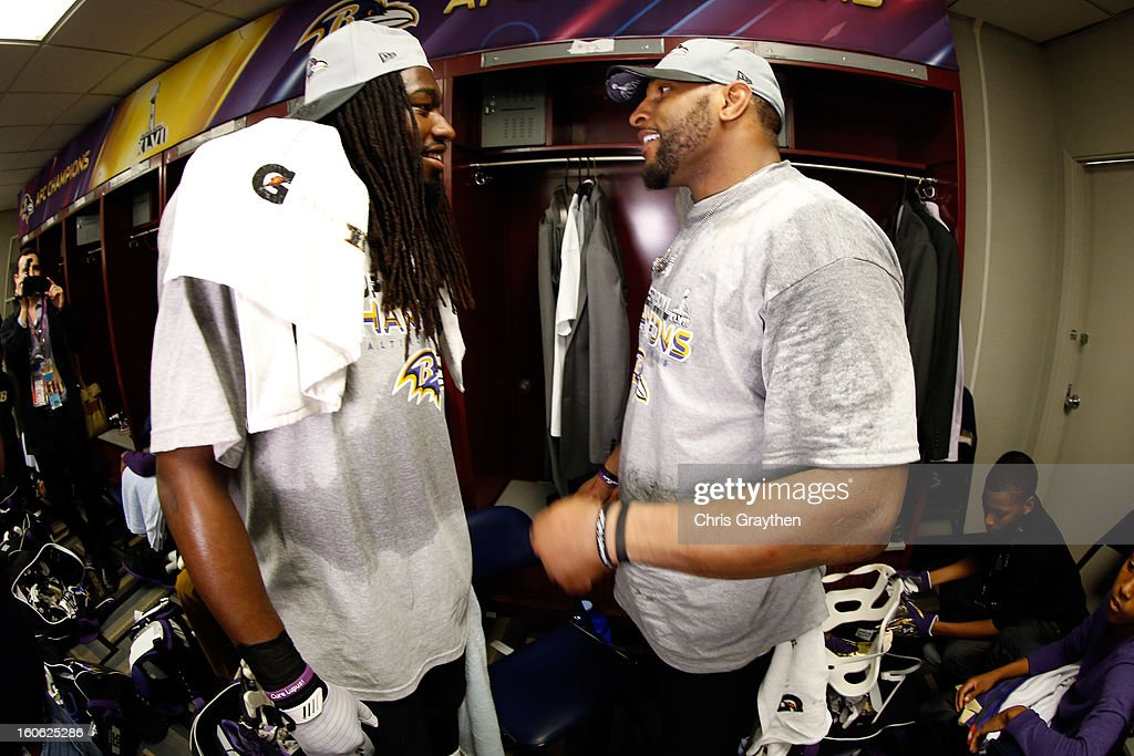Ray Lewis #52 talks with with teammate Dannell Ellerbe #59 of the Baltimore Ravens in the locker room following their 34-31 win against the San Francisco 49ers during Super Bowl XLVII at the Mercedes-Benz Superdome on February 3, 2013 in New Orleans, Louisiana.