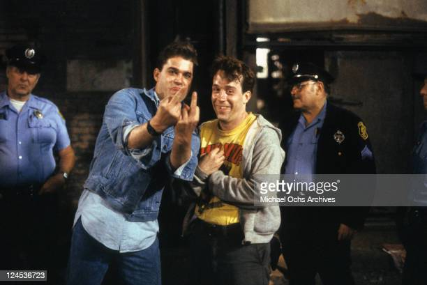 Ray Liotta and Tom Hulce giving the middle finger in a scene from the film 'Dominick And Eugene' 1988