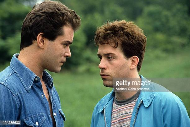 Ray Liotta and Tom Hulce staring at eachother in a scene from the film 'Dominick And Eugene' 1988