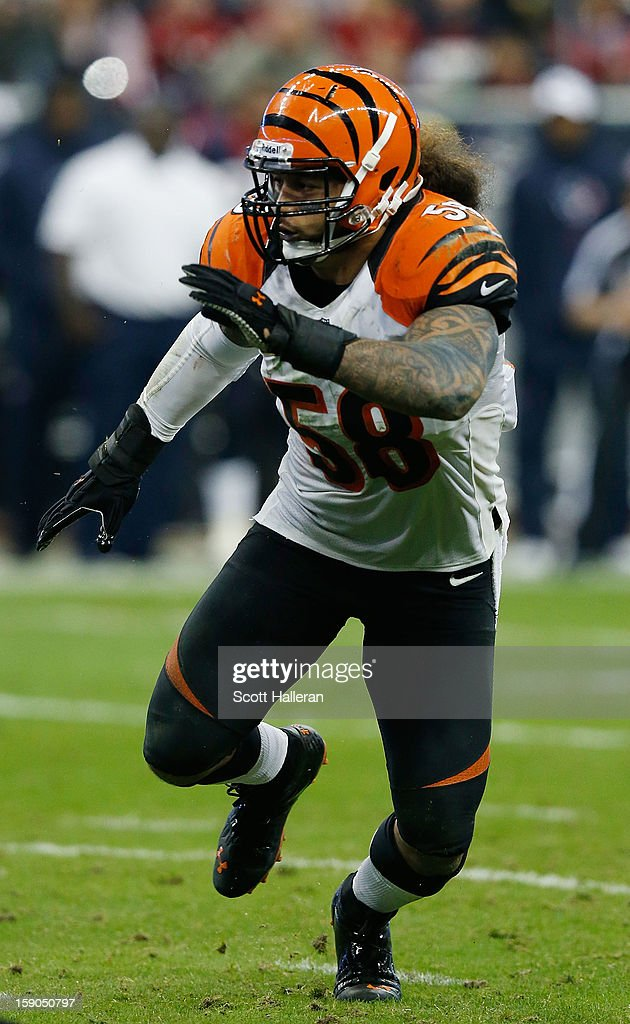 Ray Maualuga #58 of the Cincinnati Bengals runs a play during the game against the Houston Texans at Reliant Stadium on January 5, 2013 in Houston, Texas.