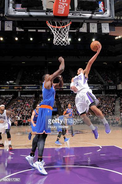 Ray McCallum of the Sacramento Kings shoots a layup against Samuel Dalembert of the New York Knicks on December 27 2014 at Sleep Train Arena in...