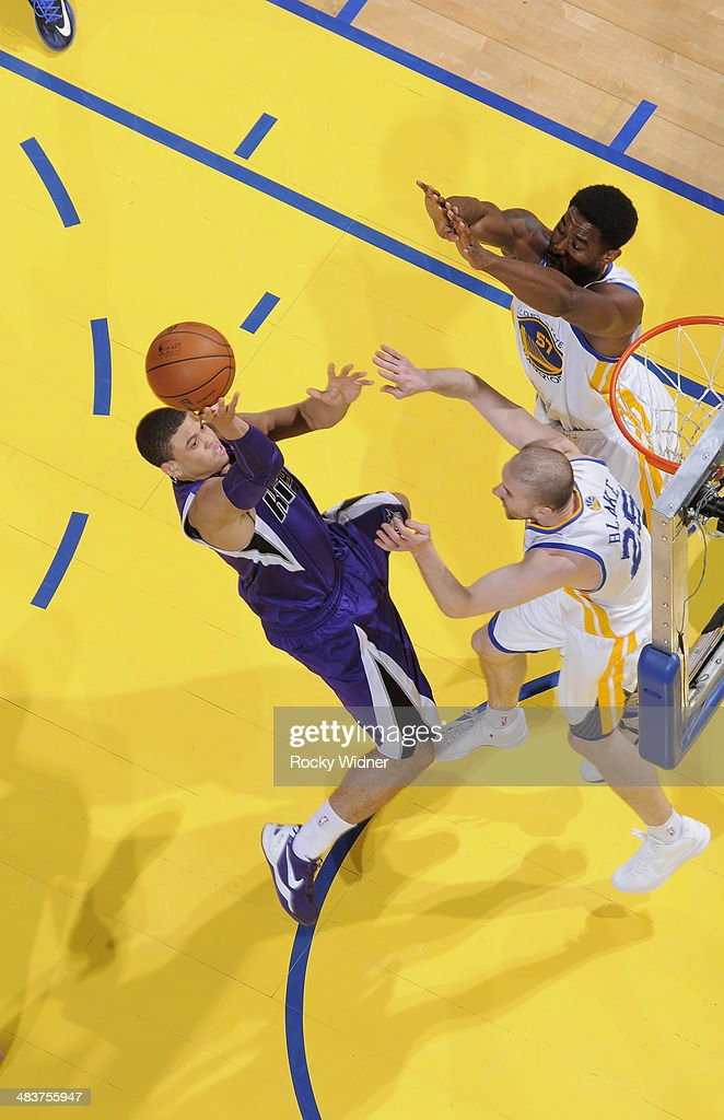 Ray McCallum #3 of the Sacramento Kings shoots against <a gi-track='captionPersonalityLinkClicked' href=/galleries/search?phrase=Steve+Blake&family=editorial&specificpeople=204474 ng-click='$event.stopPropagation()'>Steve Blake</a> #25 and Hilton Armstrong #57 of the Golden State Warriors on April 4, 2014 at Oracle Arena in Oakland, California.