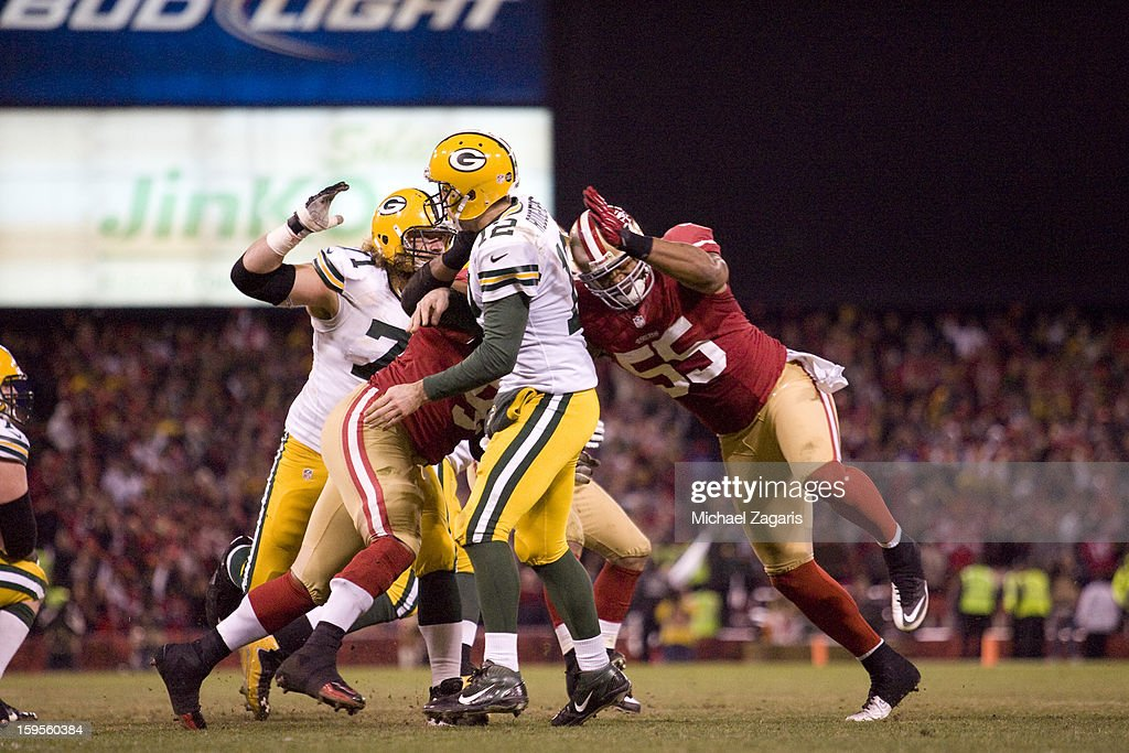 Ray McDonald #91 and Ahmad Brooks #55 of the San Francisco 49ers pressures Aaron Rogers #12 of the Green Bay Packers at Candlestick Park on January 12, 2012 in San Francisco, California. The 49ers defeated the Packers 45-31.