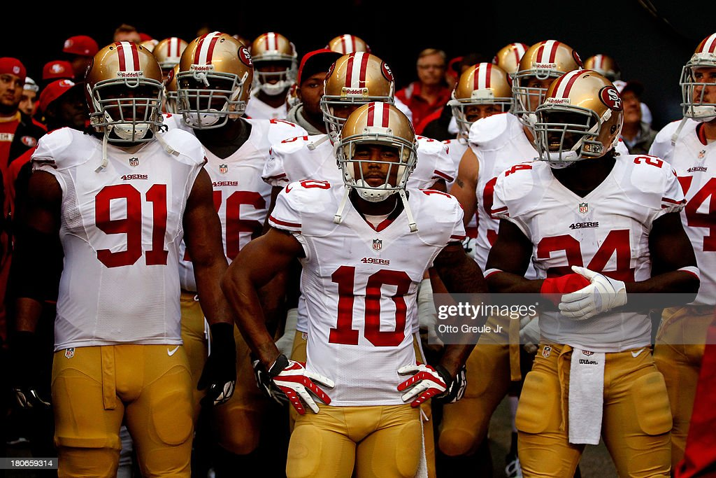 <a gi-track='captionPersonalityLinkClicked' href=/galleries/search?phrase=Ray+McDonald+-+American+Football+Player&family=editorial&specificpeople=10176443 ng-click='$event.stopPropagation()'>Ray McDonald</a> #91, <a gi-track='captionPersonalityLinkClicked' href=/galleries/search?phrase=Kyle+Williams+-+American+Football+Wide+Receiver&family=editorial&specificpeople=9642741 ng-click='$event.stopPropagation()'>Kyle Williams</a> #10 and Anthony Dixon #24 of the San Francisco 49ers stand in the tunnel prior to their game against the Seattle Seahawks at Qwest Field on September 15, 2013 in Seattle, Washington.