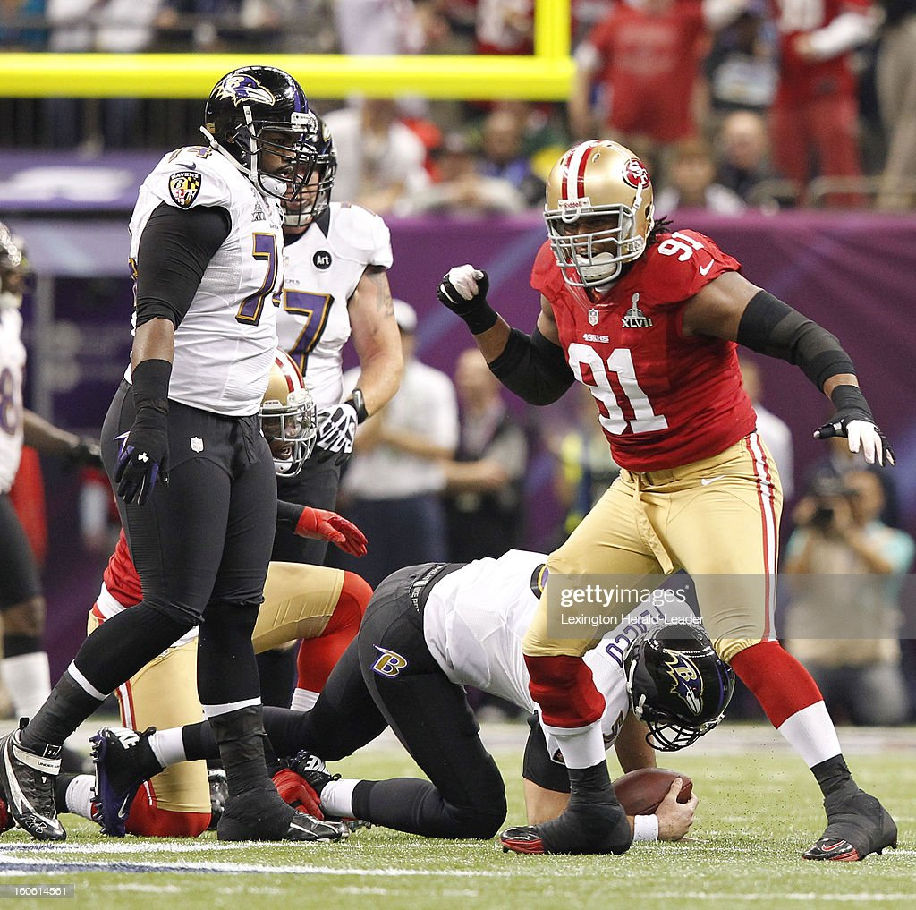 Ray McDonald (91) of the San Francisco 49ers celebrates after sacking Joe Flacco (5) of the Baltimore Ravens in first-quarter action in Super Bowl XLVII at the Mercedes-Benz Superdome in New Orleans, Louisiana, Sunday, February 3, 2013.