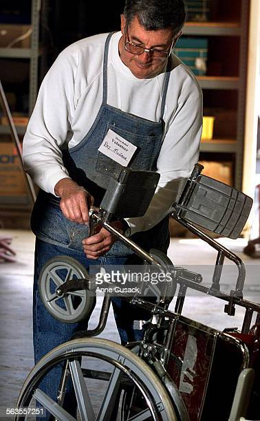 Ray Munana age 70 from Santa Barbara a volunteer at Direct Relief International in Goleta repairs a donated wheelchair Ray was an engineering...
