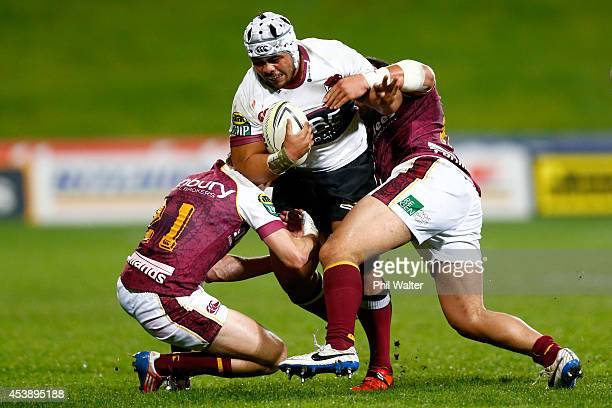 Ray Niuia of North Harbour is tackled during the round two ITM Cup match between North Harbour and Southland at QBE Stadium on August 21 2014 in...