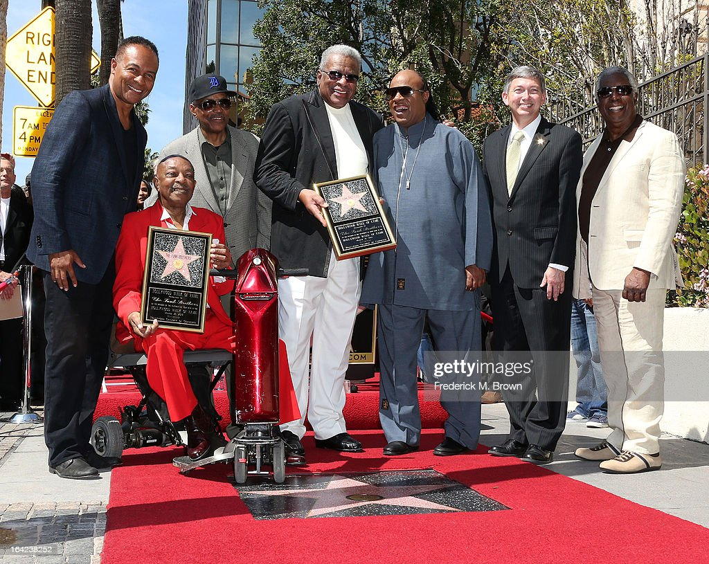 Ray Parker, Jr., Eddie Willis, Paul Reiser, Jack Ashford, Stevie Wonder, Leron Gubler, Emcee: Hollywood Chamber of Commerce, President, and Mickey Stevenson, during the ceremony honoring The Funk Brothers on The Hollywood Walk Of Fame on March 21, 2013 in Hollywood, California.