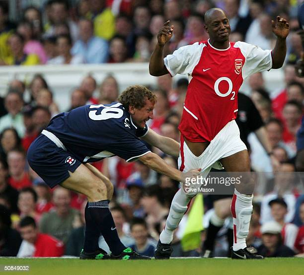 Ray Parlour of England XI pulls down the shorts of Ian Wright of Arsenal during the Martin Keown Testimonial match between Arsenal and England XI at...