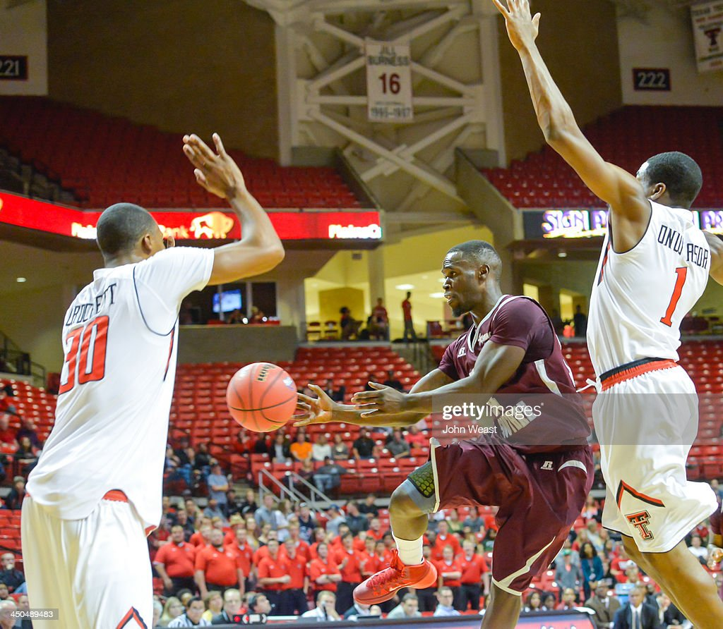 Ray Penn #14 of the Texas Southern Tigers looks to pass the ball during game against the Texas Tech Red Raiders on November 18, 2013 at United Spirit Arena in Lubbock, Texas. Texas Tech won the game 80-71.