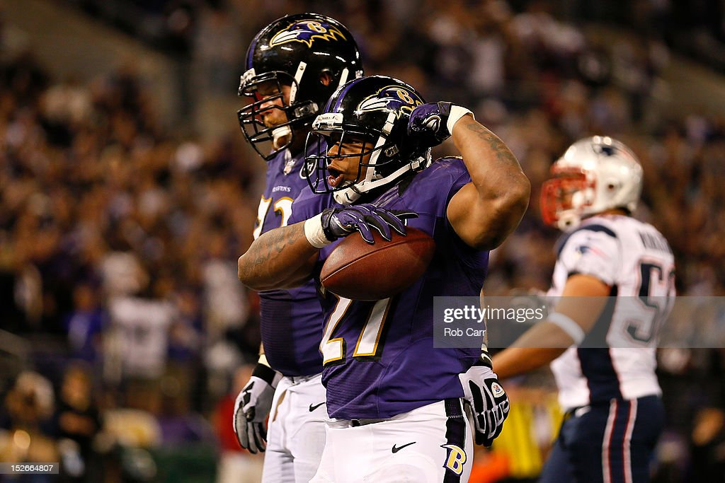 <a gi-track='captionPersonalityLinkClicked' href=/galleries/search?phrase=Ray+Rice&family=editorial&specificpeople=3980395 ng-click='$event.stopPropagation()'>Ray Rice</a> #27 of the Baltimore Ravens celebrates after he scored a 7-yard rushing touchdown in the third quarter against the New England Patriots at M&T Bank Stadium on September 23, 2012 in Baltimore, Maryland.