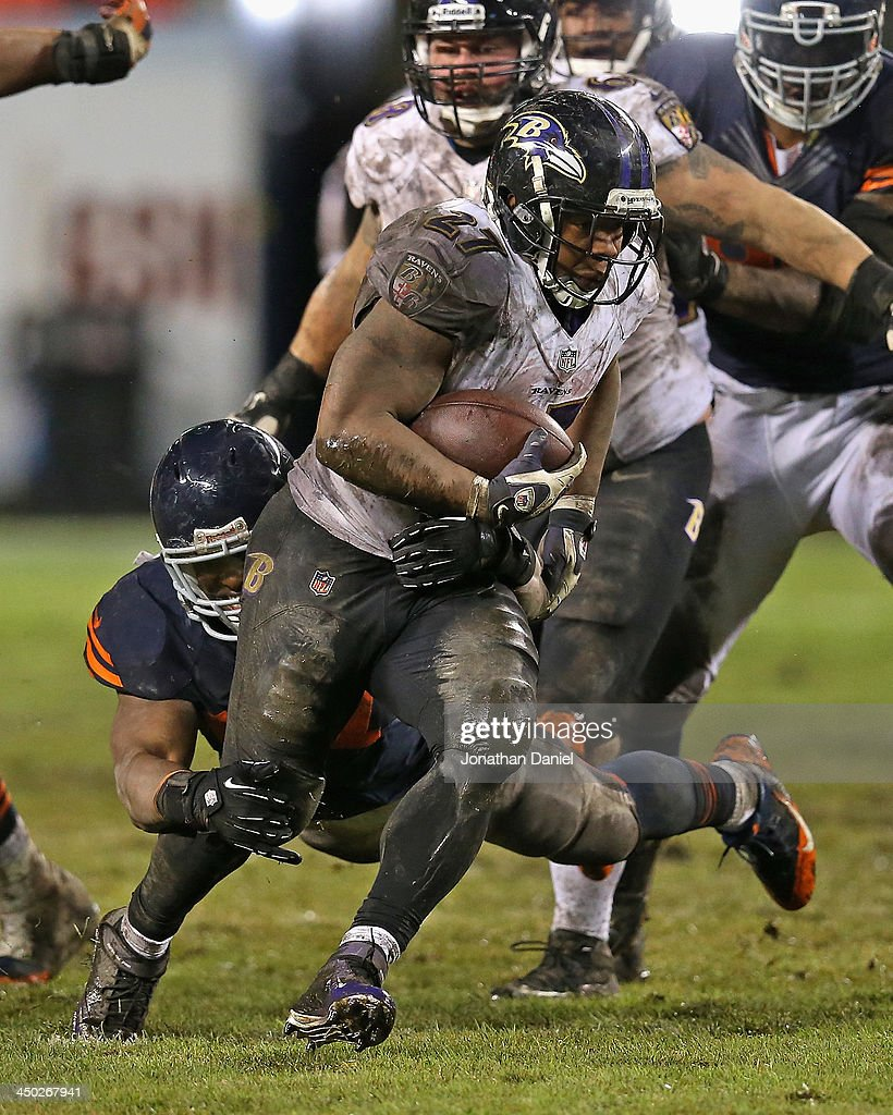 Ray Rice #27 of the Baltimore Ravens is grabbed by Jonathan Bostic #57 of the Chicago Bears at Soldier Field on November 17, 2013 in Chicago, Illinois. The Bears defeated the Ravens 23-20 in overtime.