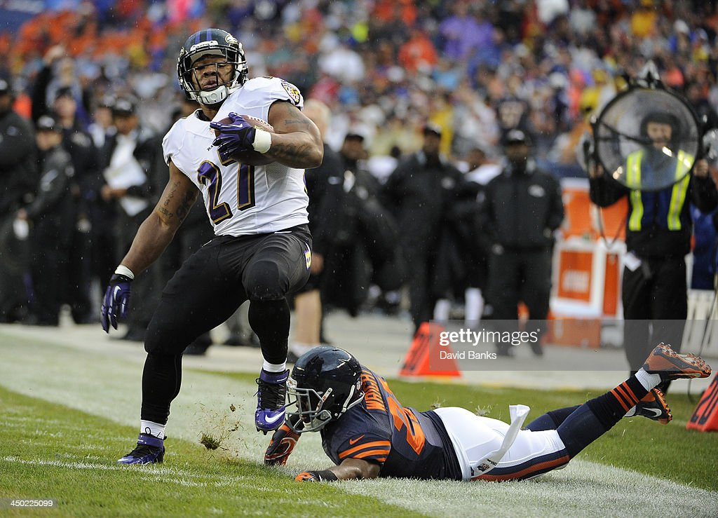 <a gi-track='captionPersonalityLinkClicked' href=/galleries/search?phrase=Ray+Rice&family=editorial&specificpeople=3980395 ng-click='$event.stopPropagation()'>Ray Rice</a> #27 of the Baltimore Ravens is tackled by <a gi-track='captionPersonalityLinkClicked' href=/galleries/search?phrase=Major+Wright&family=editorial&specificpeople=4500972 ng-click='$event.stopPropagation()'>Major Wright</a> #21 of the Chicago Bears during the first quarter during the first quarter on November 17, 2013 at Soldier Field in Chicago, Illinois.