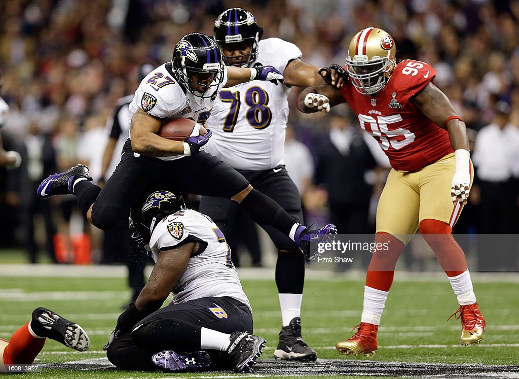 Ray Rice #27 of the Baltimore Ravens leaps over teammate Kelechi Osemele #72 while taking on the San Francisco 49ers during Super Bowl XLVII at the Mercedes-Benz Superdome on February 3, 2013 in New Orleans, Louisiana.