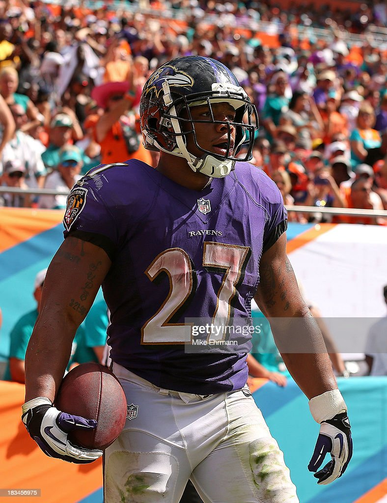 <a gi-track='captionPersonalityLinkClicked' href=/galleries/search?phrase=Ray+Rice&family=editorial&specificpeople=3980395 ng-click='$event.stopPropagation()'>Ray Rice</a> #27 of the Baltimore Ravens reacts to scoring a touchdown during a game against the Miami Dolphins at Sun Life Stadium on October 6, 2013 in Miami Gardens, Florida.