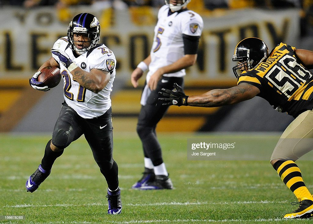 Ray Rice #27 of the Baltimore Ravens runs downfield past LaMarr Woodley #56 of the Pittsburgh Steelers on November 18, 2012 at Heinz Field in Pittsburgh, Pennsylvania. Baltimore won the game 13-10.