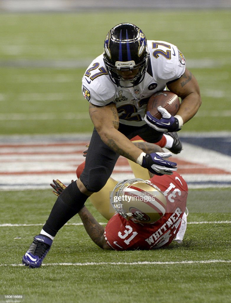 Ray Rice (27) of the Baltimore Ravens runs over Donte Whitner (31) of the San Francisco 49ers during first-half action in Super Bowl XLVII at the Mercedes-Benz Superdome in New Orleans, Louisiana, Sunday, February 3, 2013.