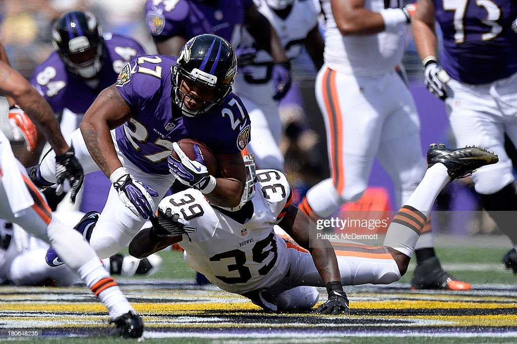 Ray Rice #27 of the Baltimore Ravens runs the ball against the Cleveland Browns during the first half of a game at M&T Bank Stadium on September 15, 2013 in Baltimore, Maryland.