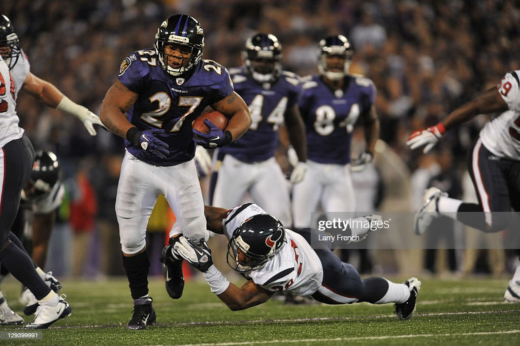 Ray Rice #27 of the Baltimore Ravens runs the ball against the Houston Texans at M&T Bank Stadium on October 16. 2011 in Baltimore, Maryland. The Ravens defeated the Texans 29-14.