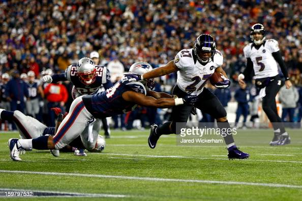 Ray Rice of the Baltimore Ravens runs the ball to score a touchdown in the second quarter against the New England Patriots during the 2013 AFC...