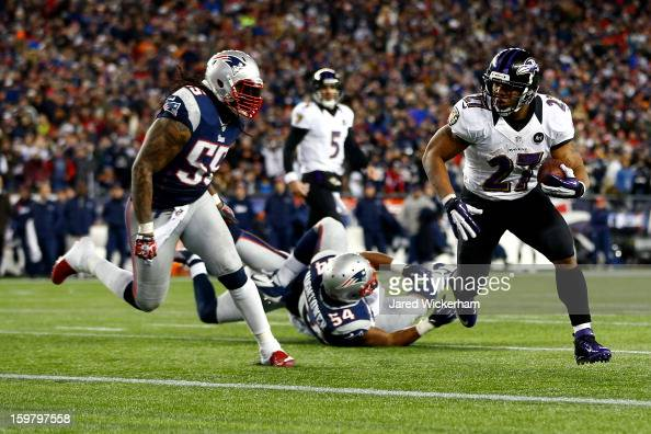 Ray Rice of the Baltimore Ravens runs the ball to score a touchdown in the second quarter against Brandon Spikes of the New England Patriots during...