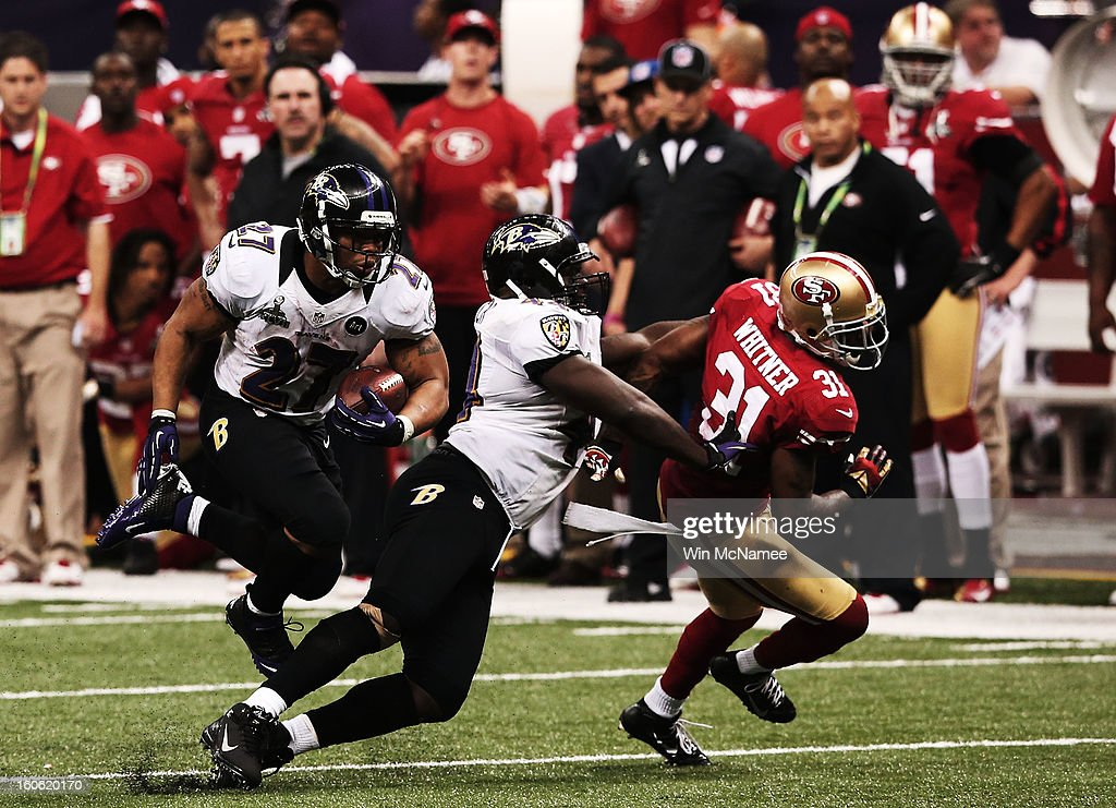 Ray Rice of the Baltimore Ravens runs with the ball in the fourth quarter behind a block by Vonta Leach against Donte Whitner of the San Francisco...