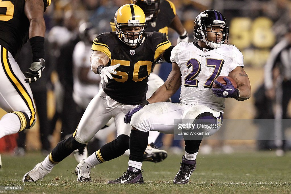<a gi-track='captionPersonalityLinkClicked' href=/galleries/search?phrase=Ray+Rice&family=editorial&specificpeople=3980395 ng-click='$event.stopPropagation()'>Ray Rice</a> #27 of the Baltimore Ravens runs with the ball while evading a tackle by <a gi-track='captionPersonalityLinkClicked' href=/galleries/search?phrase=Larry+Foote&family=editorial&specificpeople=213619 ng-click='$event.stopPropagation()'>Larry Foote</a> #50 of the Pittsburgh Steelers during the game on November 6, 2011 at Heinz Field in Pittsburgh, Pennsylvania.