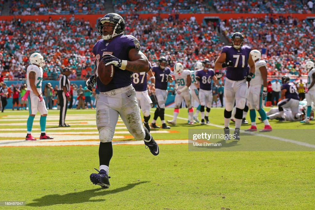 <a gi-track='captionPersonalityLinkClicked' href=/galleries/search?phrase=Ray+Rice&family=editorial&specificpeople=3980395 ng-click='$event.stopPropagation()'>Ray Rice</a> #27 of the Baltimore Ravens scores a touchdown during a game against the Miami Dolphins at Sun Life Stadium on October 6, 2013 in Miami Gardens, Florida.